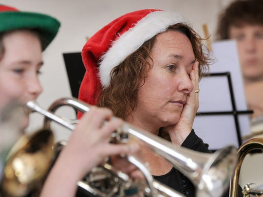 Don't be overwhelmed by holiday activities. A member of the Victorian State Youth Brass Band looks weary as she participates in an attempt to set a new record in the Guinness Book of Records for playing Christmas carols in Melbourne, Australia.