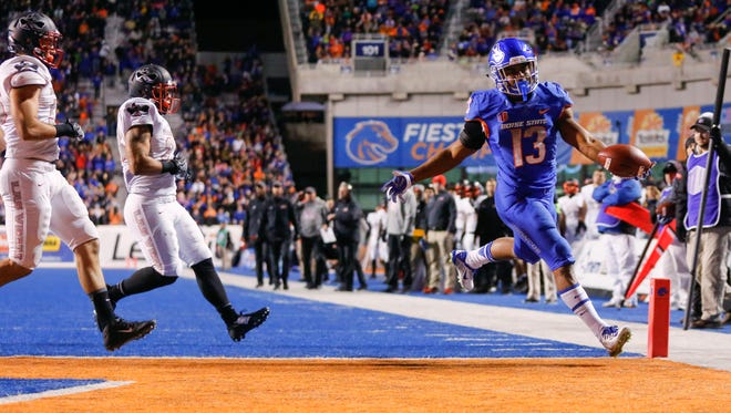Boise State running back Jeremy McNichols runs in for a touchdown during the first half.
