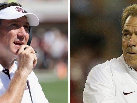 FILE - At left, in an Oct. 14, 2017, file photo, Mississippi State coach Dan Mullen watches a replay on the video board and speaks into his microphone during the first half of their NCAA college football game against Brigham Young, in Starkville, Miss. At right, in a Sept. 30, 2017, file photo, Alabama head coach Nick Saban walks the field before an NCAA college football game against Mississippi, in Tuscaloosa, Ala. No. 1 Alabama plays at No. 18 Mississippi State on Saturday. (AP Photo/File)