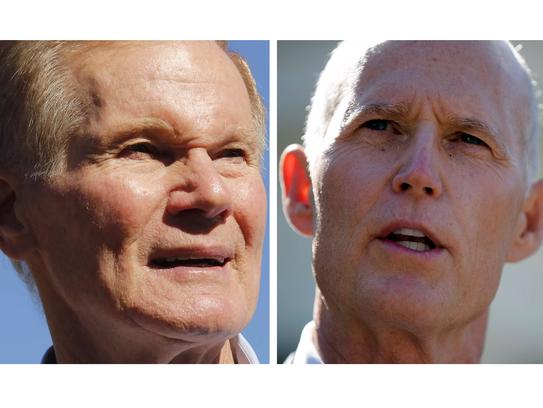 Sen. Bill Nelson, left, and Gov. Rick Scott