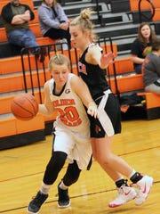 Gibsonburg's Becca Morelock drives to the basket against Cardinal Stritch's Erika Berg.