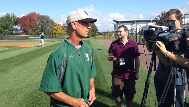 Binghamton University baseball coach Tim Sinicki gets ready to talk to reporters before Scout Day at Varsity Field in October 2014.