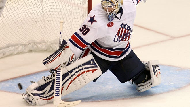 Amerks goalie Matt Hackett makes a pad save in a 4-1 win over Utica.