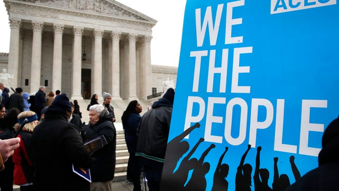 In this Jan. 10, 2018, file photo, people rally outside of the Supreme Court in opposition to Ohio's voter roll purges in Washington. The Supreme Court's decision upholding Ohio's method of removing people from voter rolls appears unlikely to have a ripple effect. Ohio followed the most aggressive path among states that have laws targeting inactive voters. (AP Photo/Jacquelyn Martin, File)