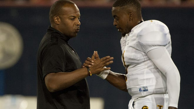 Grambling's Broderick Fobbs, left, took home SWAC Coach of the Year, on Thursday, while QB DeVante Kincade, right, was named SWAC Offensive Player of the Year.