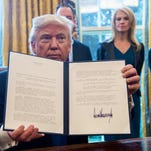 Trump signs five more orders on pipelines, steel and environment