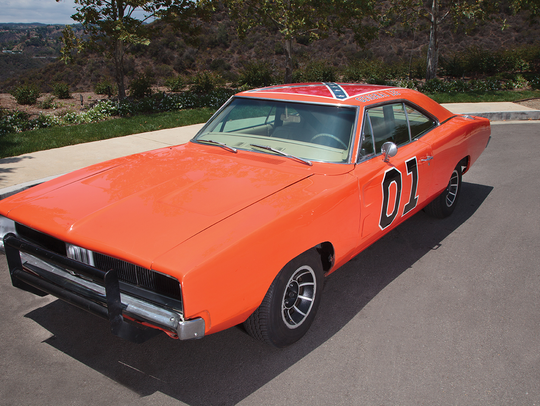 This General Lee, with a Confederate flag on the roof,