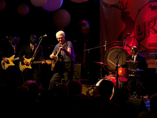 Nick Lowe performing with Los Straitjackets