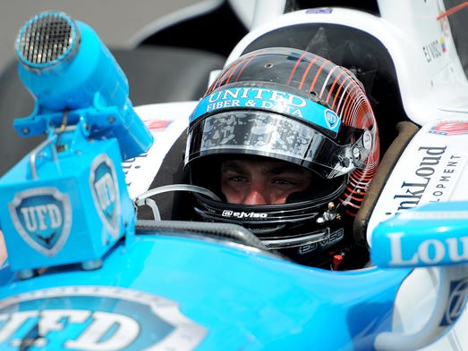 E.J. Viso tries to keep cool as temperatures rise during the second day of practice for the Indy 500 at the Indianapolis Motor Speedway, Monday, May 12, 2014, in Indianapolis.