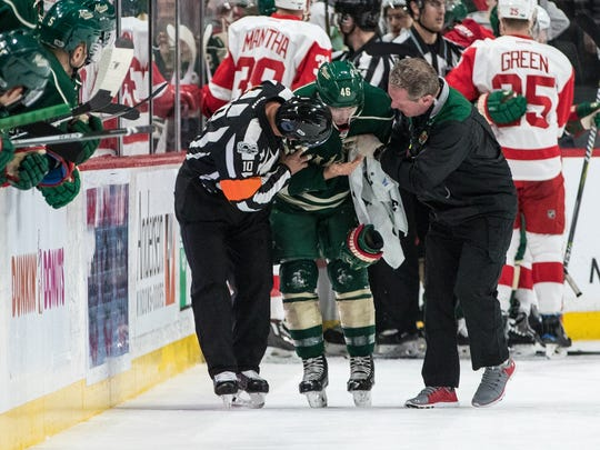 Feb 12, 2017; Saint Paul, MN, USA; Minnesota Wild defenseman Jared Spurgeon is helped off the ice following a high-stick from the Red Wings' Gustav Nyquist in the first period at Xcel Energy Center.