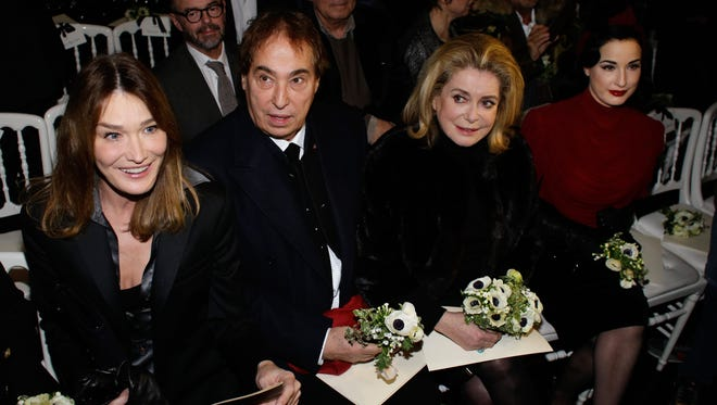 Carla Bruni-Sarkozy (L), Catherine Deneuve (2R), and Dita Von Teese (R) attend Jean Paul Gaultier's Spring-Summer 2015 Haute Couture fashion collection, presented in Paris, France, Wednesday, Jan. 28, 2015.