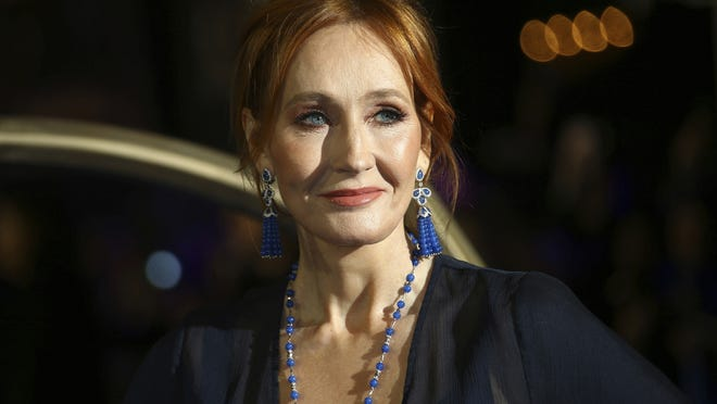 "J.K. Rowling poses for photographers upon her arrival at the premiere of the film ""Fantastic Beasts: The Crimes of Grindelwald"" in 2018. Rowling's new story, ""The Ickabog,"" is being published online in installments and is free to read online."