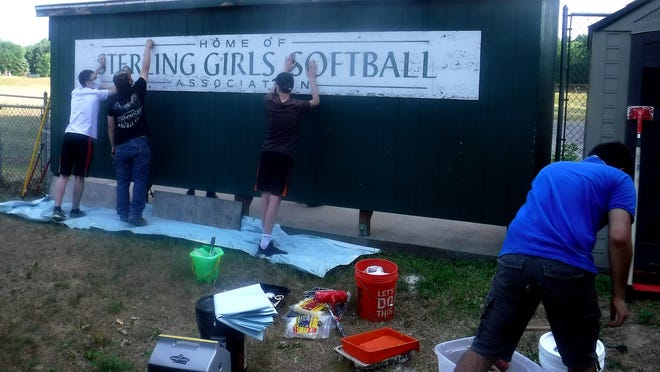 Working on the Sterling Girls Softball dugout are (from left) Karlen Michalak, Jarek Michalak, Charlie Smith and Rishi Krishana.