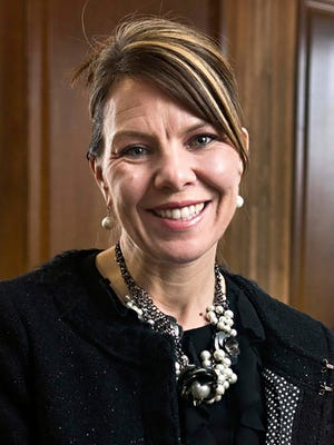 In this 2017 photo, Jennifer Riordan, of Albuquerque, N.M., poses for a photo in Albuquerque. Family, friends and community leaders are mourning the death of Riordan, a bank executive on a Southwest Airlines jet that blew an engine as she was flying home from a business trip to New York.