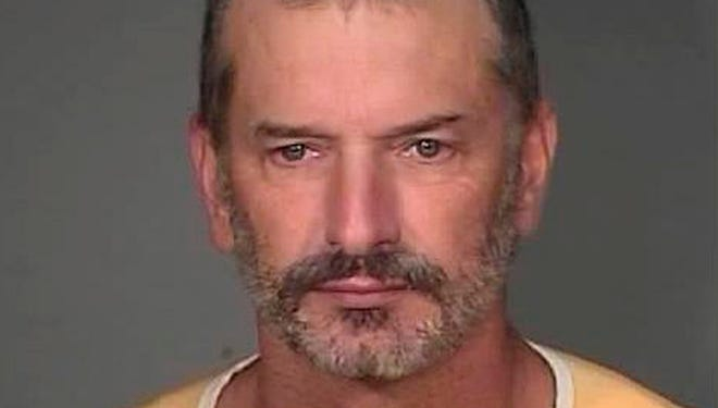 This Aug. 19, 2010, file photo provided by the Mohave County Sheriff's Office shows John Charles McCluskey, 45, after he was captured at a campsite in the Apache-Sitgreaves National Forest in Arizona.