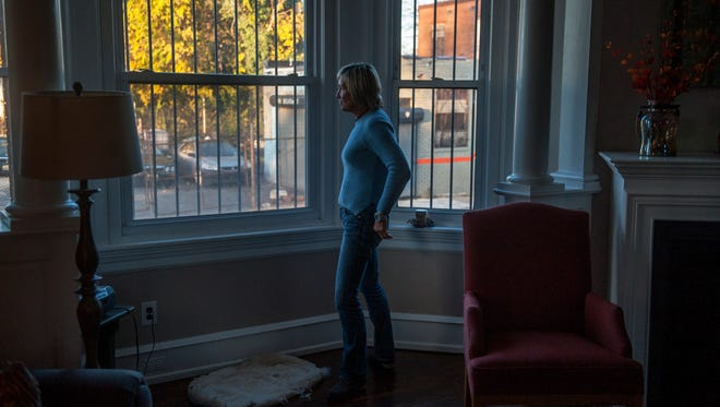 "Brenda Antinore, director of ""She Has A Name"", an outreach ministry for women who are trapped in the bondage of addiction and prostitution, looks out of a window of her South Camden home."
