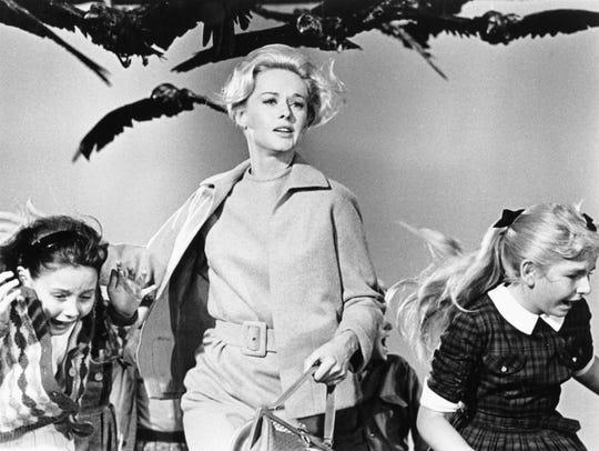 """Tippi Hedren (center) stars in """"The Birds,"""" one of"""