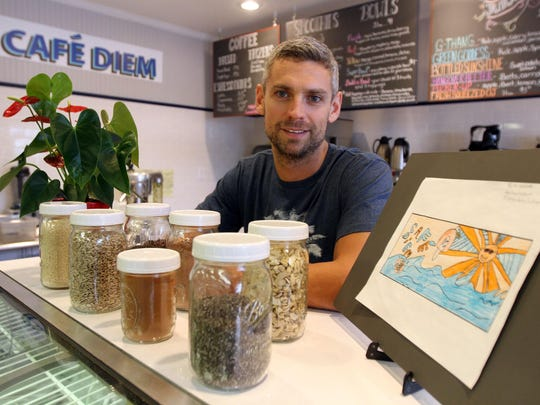 Café Diem owner Darren Moore is shown at his shop located inside Wallach's Farm Market & Deli on Route 9 in Toms River.