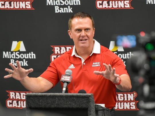 Cajuns coach Mark Hudspeth at the podium for UL football Media Day earlier this month.