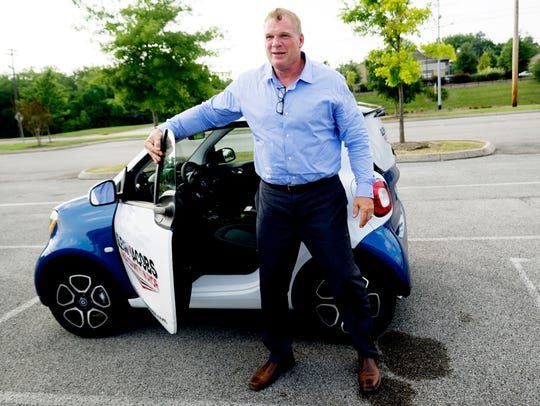 Glenn Jacobs exits his Smart ForTwo Prime during a