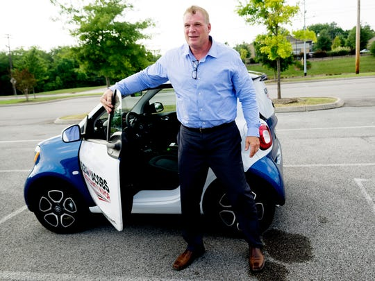 Glenn Jacobs exits his Smart ForTwo Prime during a campaign stop at Casual Pint in Farragut, Tennessee on Friday, July 21, 2017. Glenn Jacobs, best known as WWE wrestler Kane, is running for Knox County Mayor.