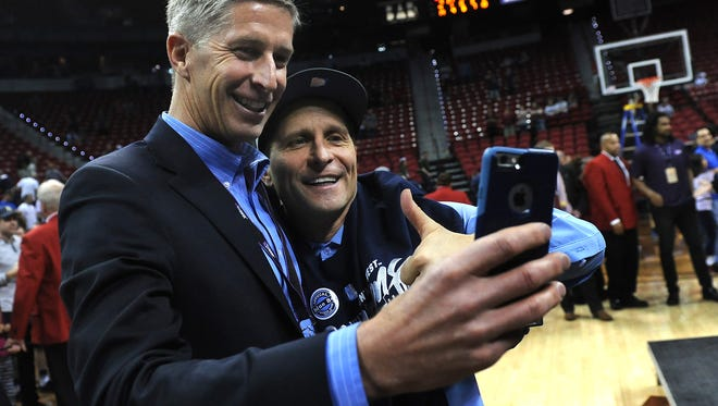Nevada head coach Eric Musselman, right, and Director of Athletics Doug Knuth take a selfie after defeating Colorado State to win the Mountain West Conference tournament final game at the Thomas & Mack Center in Las Vegas on March 11, 2017.