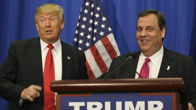Republican presidential candidate Donald Trump stands with New Jersey Gov. Chris Christie before a rally in Fort Worth, Texas.