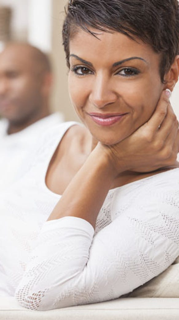 her black-woman-with-short-hair-smiling-next-to-man-shutterstock-PF