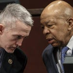 FILE - In this Jan. 27, 2015 file photo, House Benghazi committee chairman Rep. Trey Gowdy, R-S.C., left, confers with the committee's ranking member, Rep. Elijah Cummings, D-Md., during a hearing on Capitol Hill in Washington.