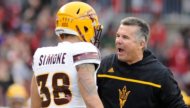 Arizona State Sun Devils head coach Todd Graham talks with Arizona State Sun Devils defensive back Jordan Simone (38) during a game against the Washington State Cougars during the second half at Martin Stadium. The Cougars won 30-24.