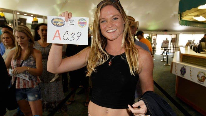 """Ashley Nolan of Satellite Beach shows off her audition number at Victory Casino Cruises at Port Canaveral during an open audition for """"Survivor."""" Nolan apparently appears on season 35, """"Survivor: Heroes vs. Healers vs. Hustlers,"""" thanks to her audition at Victory."""