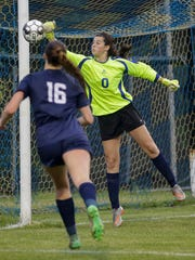 Sheboygan North's goalie Meredith Opie blocks a kick from Arrowhead during the WIAA division 1 sectional championship Saturday in Germantown.