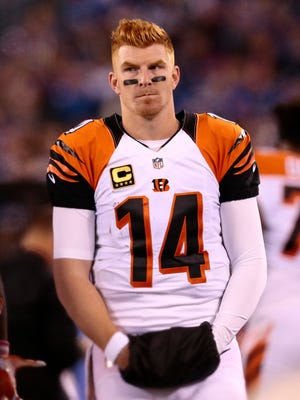 Cincinnati Bengals quarterback Andy Dalton (14) paces the sideline between drives in the second quarter of the NFL Week 10 game between the New York Giants and the Cincinnati Bengals at MetLife Stadium in East Rutherford, N.J., on Monday, Nov. 14, 2016.