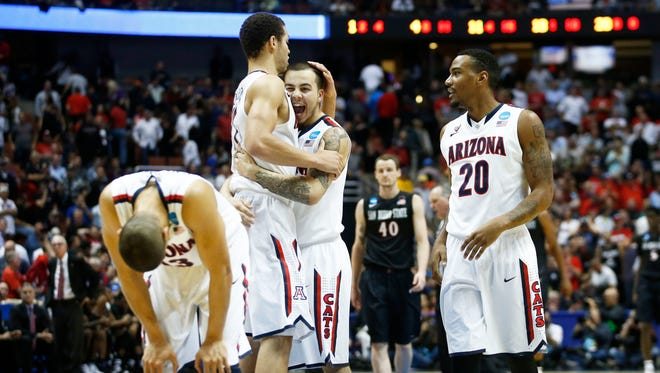 Arizona's Aaron Gordon and Gabe York enjoy their victory over San Diego State in the Sweet 16 during the NCAA tournament on Thursday, Mar. 27, 2014 at the Honda Center in Anaheim.