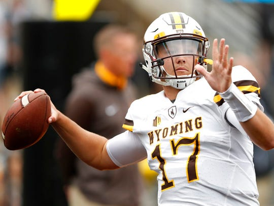 Wyoming quarterback Josh Allen warms up before Saturday's game against Iowa.