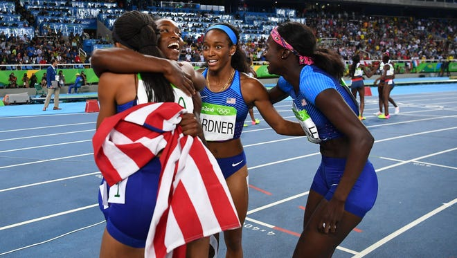 The U.S. women - from left, Allyson Felix, Tianna Bartoletta, English Gardner and Tori Bowie - unlike the men, celebrated their 4x100 relay gold medal.