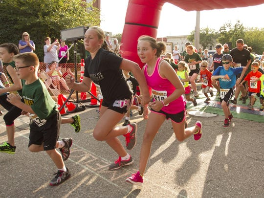 Young runners get off to a fast start in 2014's one-mile run, part of the Melon Run held tonight in Howell.