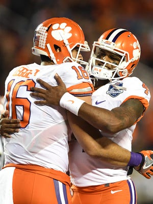 Clemson quarterback Deshaun Watson (4) hugs tight end Jordan Leggett (16) after the pair connected for a TD against Virginia Tech during the 2nd quarter of the ACC Championship at Camping World Stadium in Orlando on Saturday, December 3, 2016.