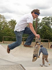 Dustin Smith plants off a pyramid box at Reid Menzer Memorial Skatepark on Sept. 30, 2016. Smith participated in a memorial to his friend Dan Glorioso, who died in July.