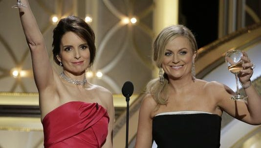 Tina Fey and Amy Poehler hosted the Golden Globes, which hit a 10-year ratings high.