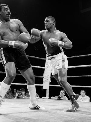 Larry Sims of Cleveland, left, and Mike Tyson battle it out in the ring at the Mid-Hudson Civic Center on July 19, 1985 in Poughkeepsie.
