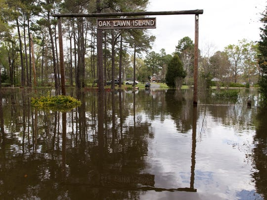 The Oak Lawn Island subdivision is cut off as flooding