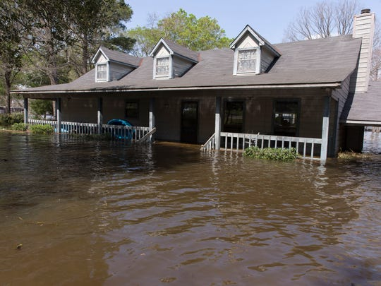 The home of Scott and Melissa Anderson is flooded as