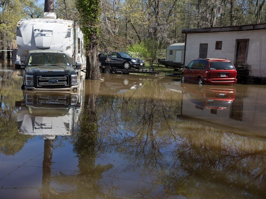 Vehicles are stranded due to flooding on Butler Camp