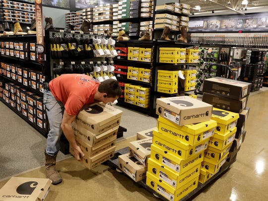 Brennan Suire stocks shoes at DICK'S Sporting Goods and Field and Stream stores, to open April 1, at the Ambassador Town Center in Lafayette March 22, 2016.
