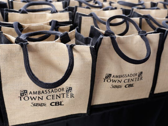 Bags with sample merchandise to be given to attendees during a grand opening ceremony for the Ambassador Town Center in Lafayette March 23, 2016.