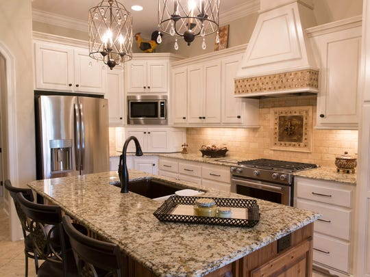 The kitchen of 329 Dunvegan Court in Stonehaven on the River, featured in the spring Parade of Homes  March 29, 2016.