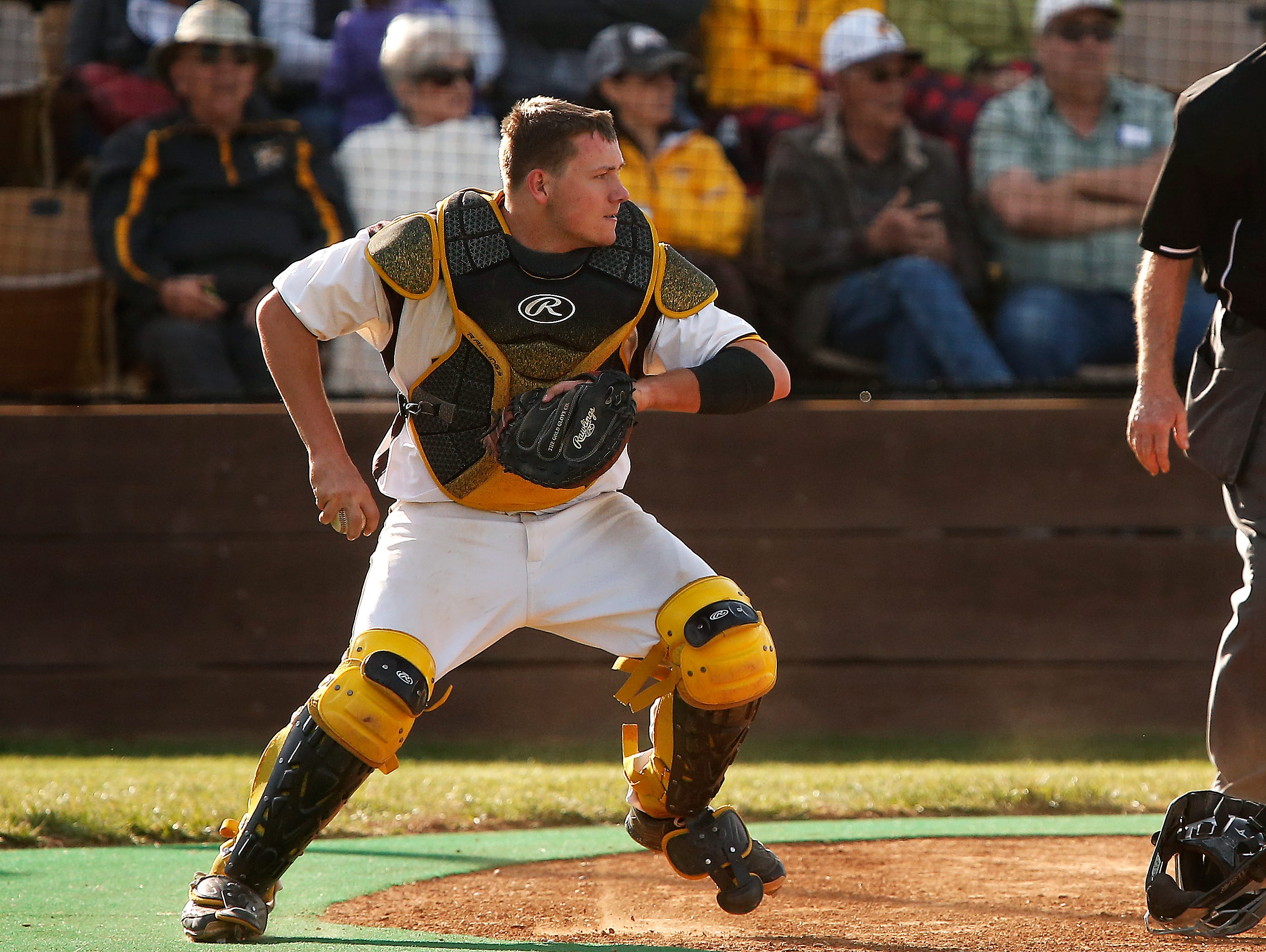 Kickapoo High School catcher Westin Gann (15) throws the ball to third base during fourth inning action of the high school baseball game between Kickapoo and Ozark at Kickapoo High School in Springfield, Mo. on March 29, 2016.