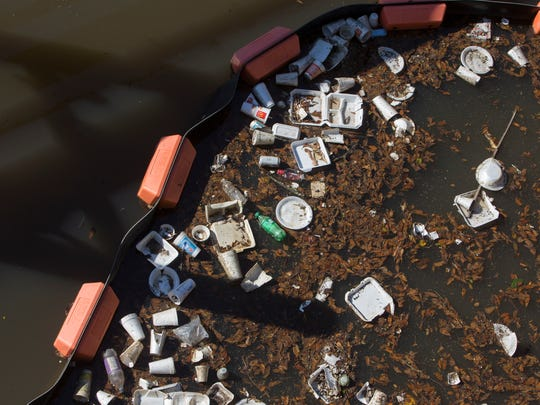 A trash boom in the Vermilion at the South College bridge.