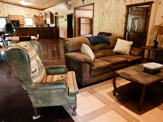 A seating area inside the lodge at the Knobbhill Hunting Lodge in Ville Platte.